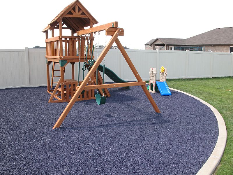 Rubber mulch under swing set.